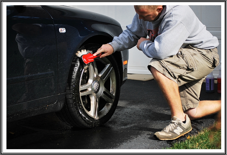 Scrubbing 2006 Audi A4 wheels with wheel/tire scrub brush