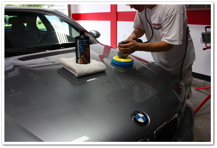 Applying Blackfire Wet Diamond to a BMW M3 with a blue finessing pad and Porter Cable 7424 XP