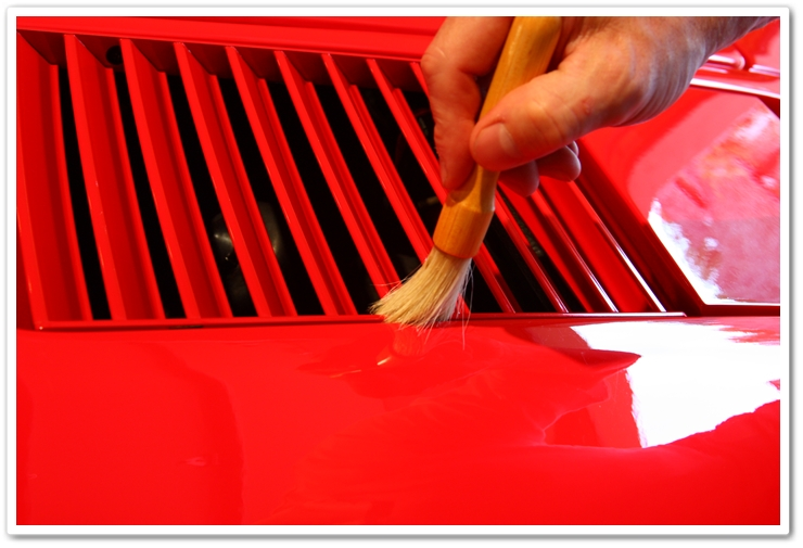 Cleaning out polishing residue on a 1985 Ferrari 288 GTO with a boars hair brush