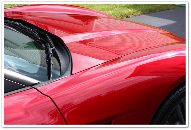 2008 Crystal Red Metallic Corvette topped with Blackfire Wet Diamond paint sealant