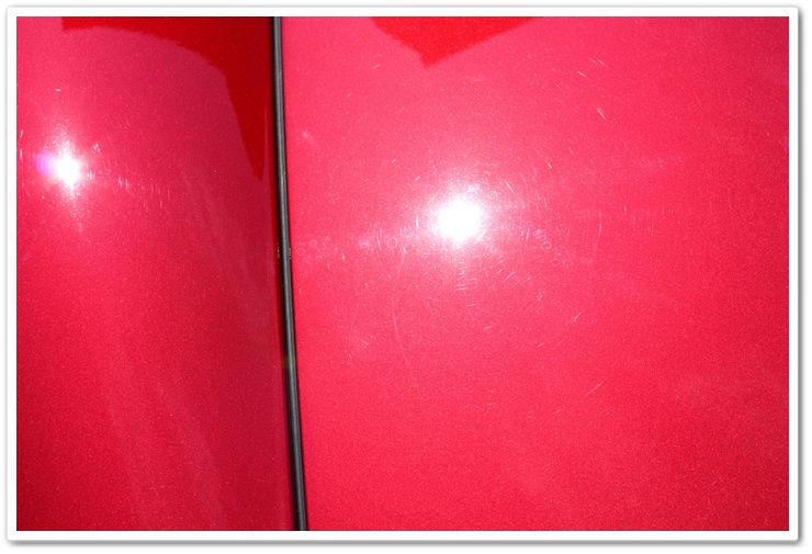 Swirls on a newly delivered 2008 Cyrstal Red Metallic Chevy Corvette prior to properly detailing
