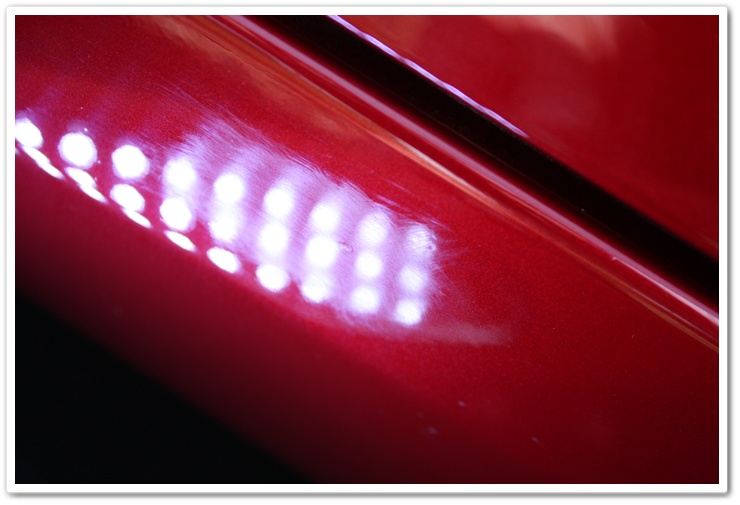 Unpolished paint on a newly delivered 2008 Chevy Corvette in Crystal Red Metallic