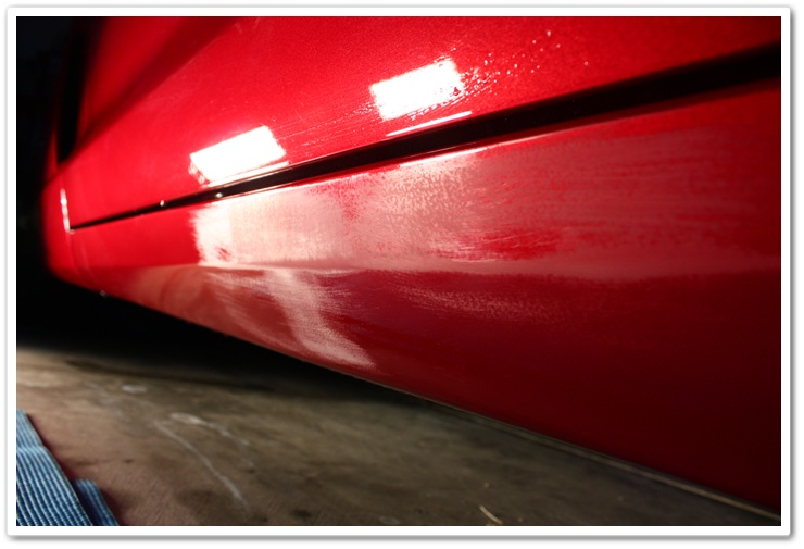 Rocker panels of a 2008 Chevy Corvette wetsanded to remove imperfections