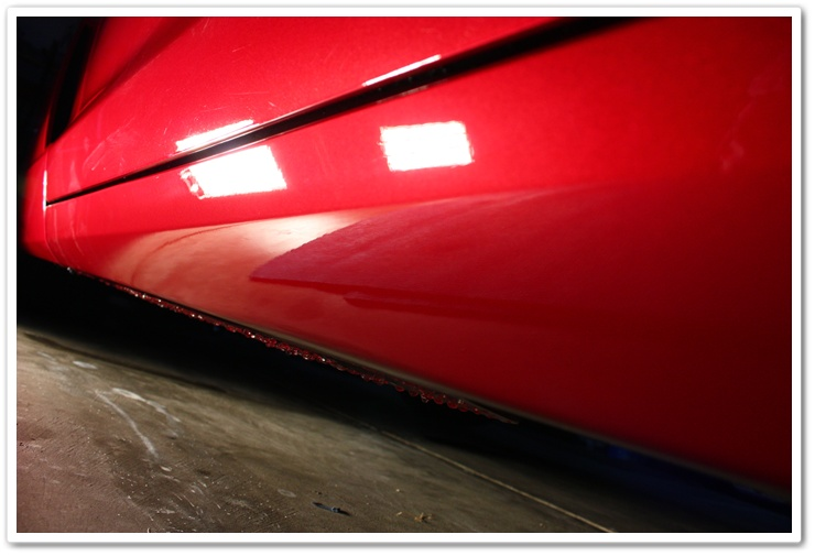 Rocker panels of a 2008 Chevy Corvette after wetsanding and polishing