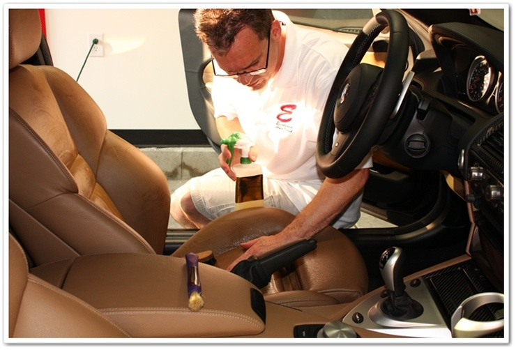 Massaging Leatherique Prestine Clean into BMW M6 leather with bare hands