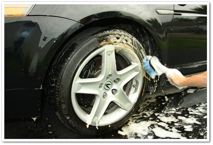 Scrubbing the tires with Optimum Power Clean and a brush