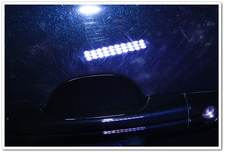 Acura TL in NBP showing swirls and scuffs above the door handle prior to an Esoteric Auto Detail