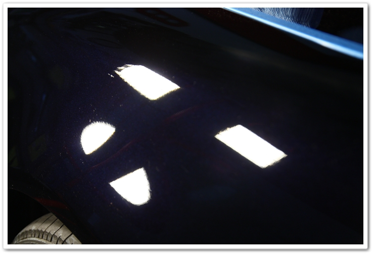 Corrected fender of a 2007 Acura TL in NBP after 1 pass of Power Finish on an orange pad
