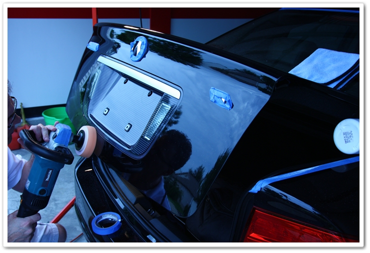 Polishing the lower portion of your trunk while it's proper open to avoid damaging the lower bumper