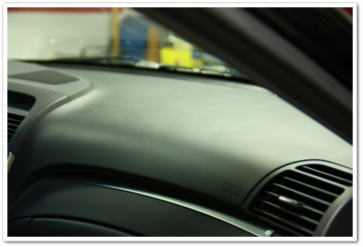 Optimum Protectant Plus applied to the interior dash of an Acura TL