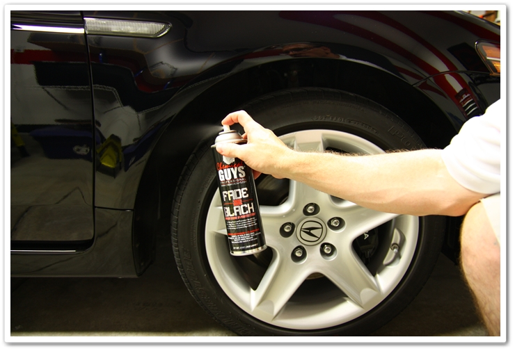 Applying Chemical Guys Fade 2 Black to wheel wells to give a dark black finish