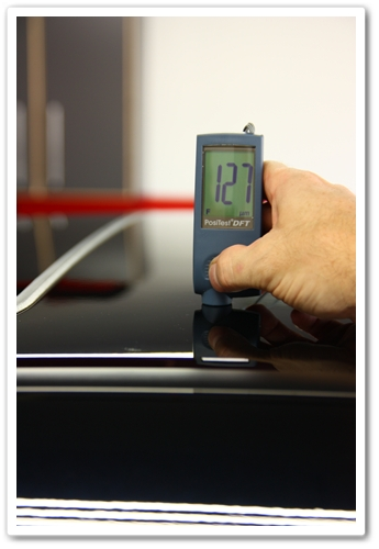 Taking measurement of the thickness of paint on a 2007 NBP Acura TL