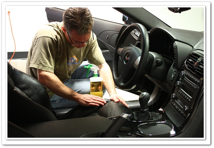 Working Leatherique into Chevy Corvette leather with bare hands