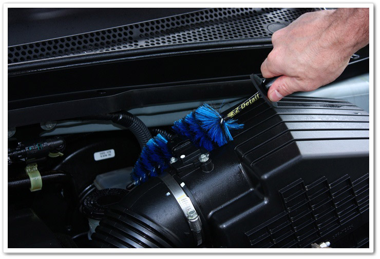 Using a Mini E-Z Detail Brush to clean engine bay