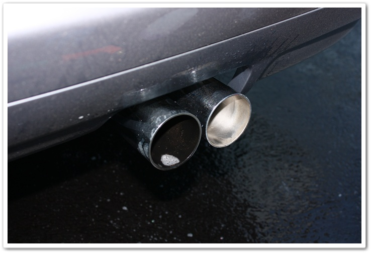 Before and after BMW M3 exhaust tips cleaneded with Chemical Guys Grime Reaper