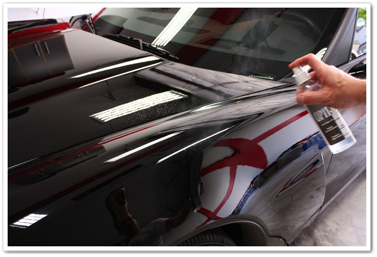 Optimum Opti-Seal misted onto paint for application on a black Corvette
