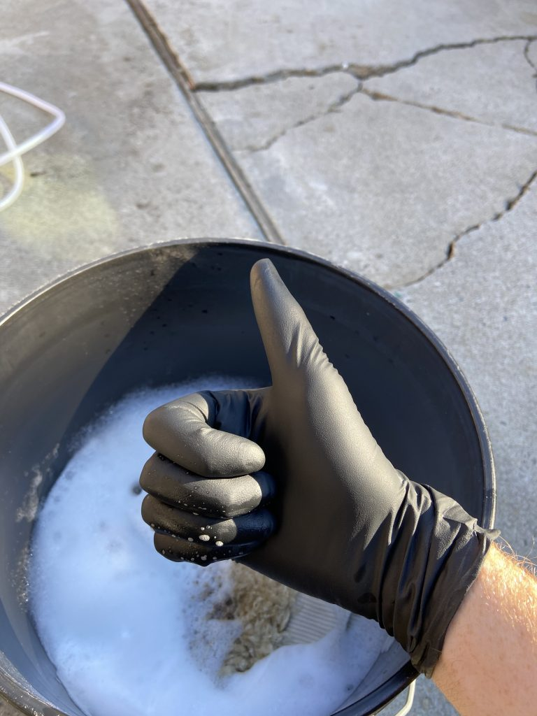 Winter washing tips hand with nitrile glove