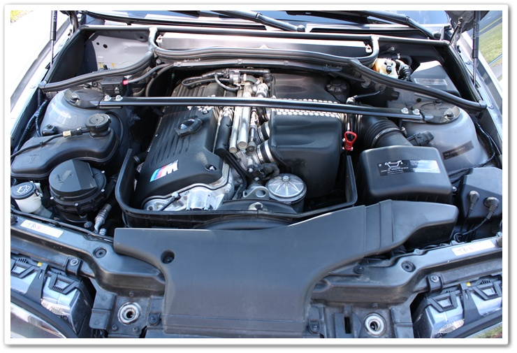 2005 BMW M3 engine bay before being detailed by Esoteric Auto Detail
