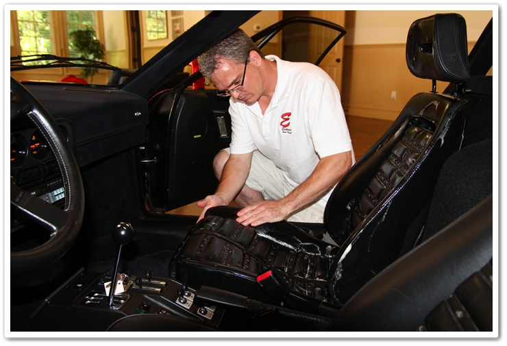 Massaging Leatherique Rejuvenator Oil into Ferrari leather with bare hands