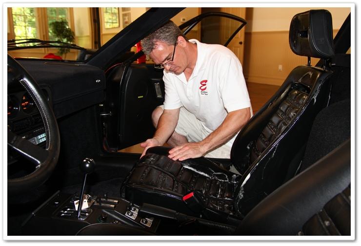 Massaging Leatherique Rejuvenator Oil into Ferrari leather with bare hands