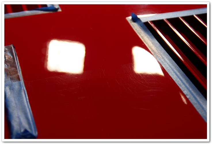 50/50 shot of a rear deck lid polished with Menzerna SIP and an orange pad on a Ferrari 288 GTO