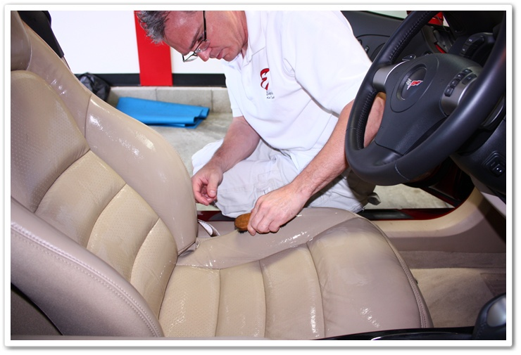 Cleaning contaminated leather stains with a leather brush and Leatherique Prestine Clean on a 2008 Chevy Covette