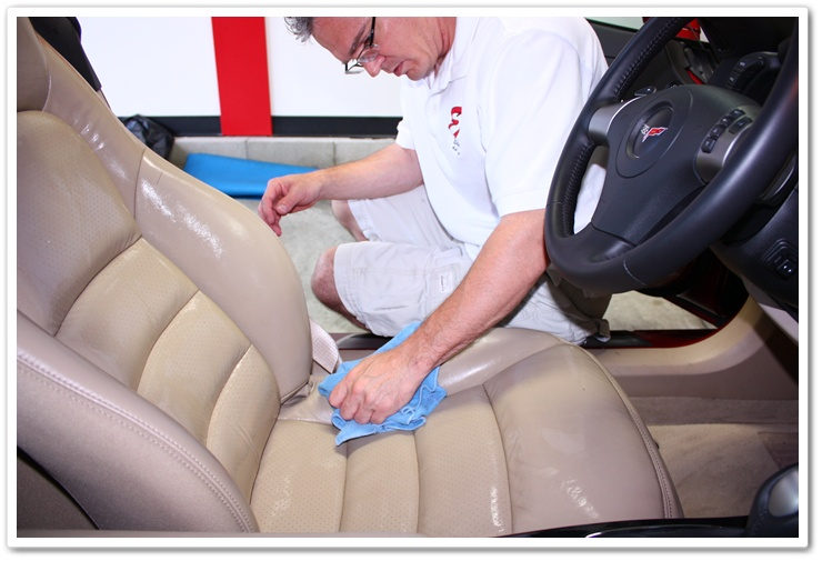 Wiping off Leatherique Prestine Clean with a damp microfiber towel on a 2008 Chevy Corvette interior