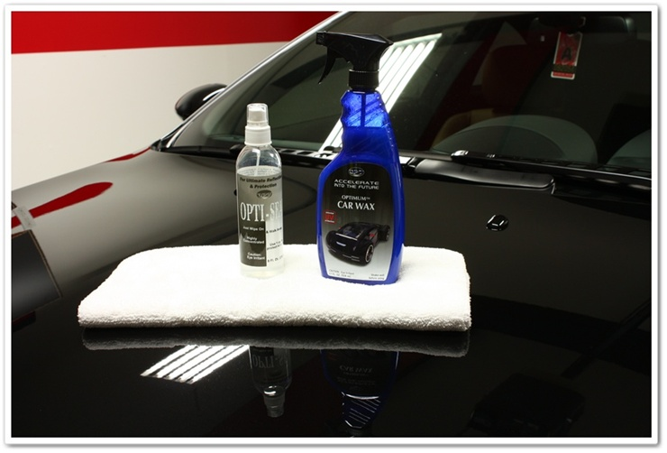 Optimum Opti-Seal and Car Wax ready to be applied to a black 2008 BMW M6