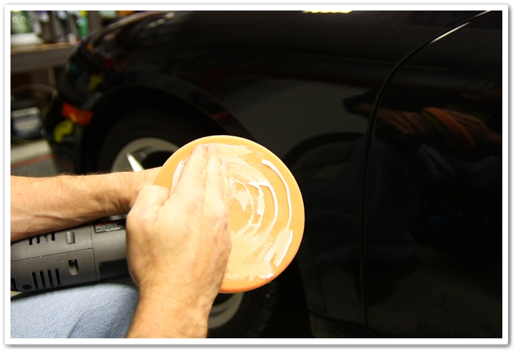 Priming the pad with Meguiar's M105 or M205 polish prior to polishing - hand wipe