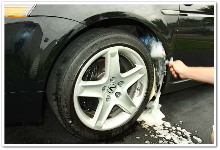 Using an E-Z Detail Brush to clean inside wheel wells
