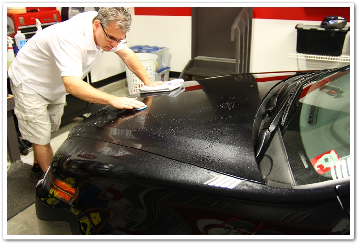 Claying the hood of a NBP 2007 Acura TL