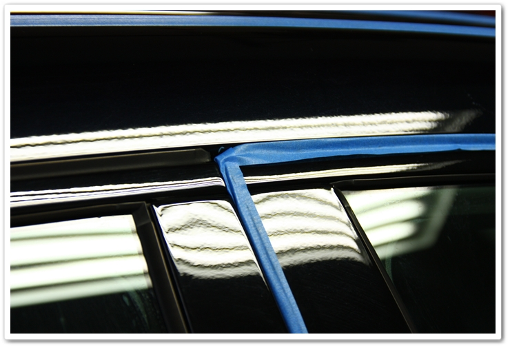 Taped up trim on a 2007 Acura TL prior to polishing in an Esoteric Auto Detail