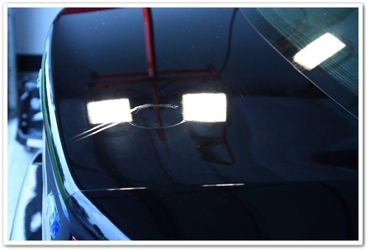 Stained paint on a 2007 Acrua TL NBP trunk lid prior to polishing