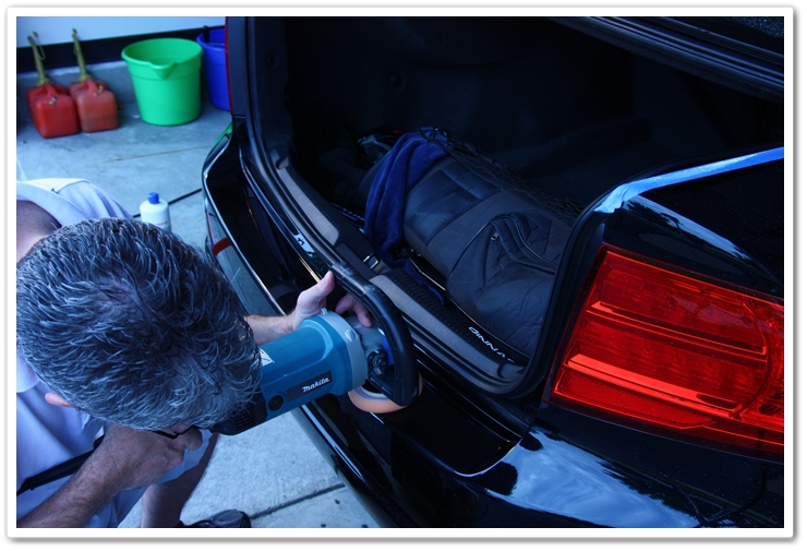 Polishing the lower bumper of an Acura TL in NBP with the trunk open