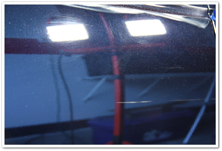 A door panel of a 2006 Acura TL in NBP prior to polishing