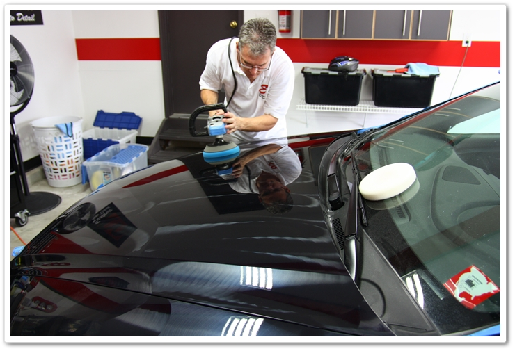 Polishing the hood of an Acura TL with Menzerna PO85RD and a blue Lake Country pad on a Makita rotary