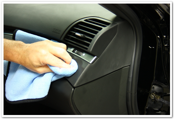 Applying Optimum Protectant Plus with a microfiber towel on an Acura TL interior