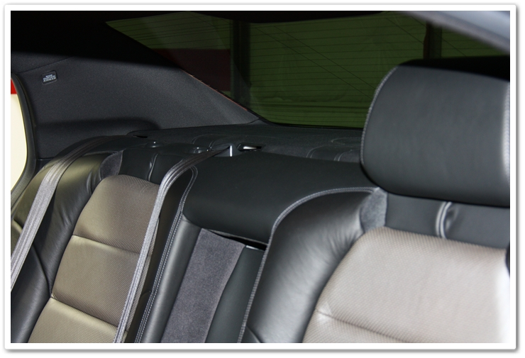 Remove the head rests prior to cleaning the rear windshield
