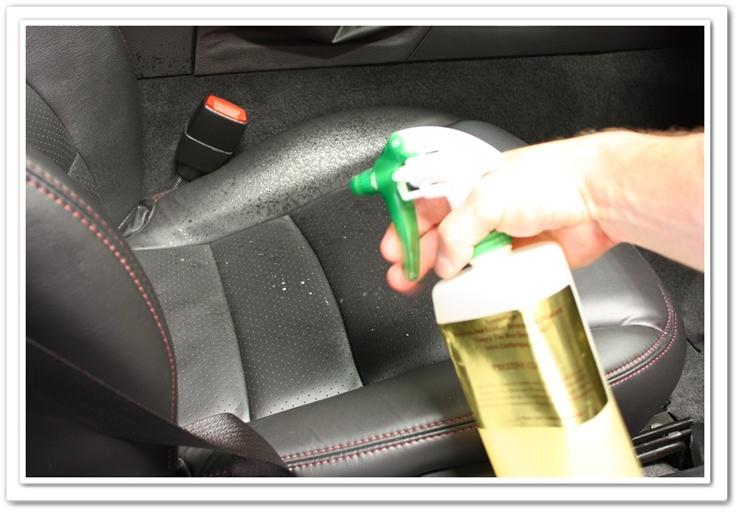 Spraying Leatherique Prestine Clean on Chevy Corvette seats