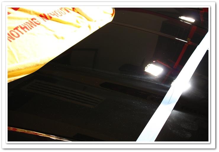 2008 black Chevy Z06 Corvette polished on top half