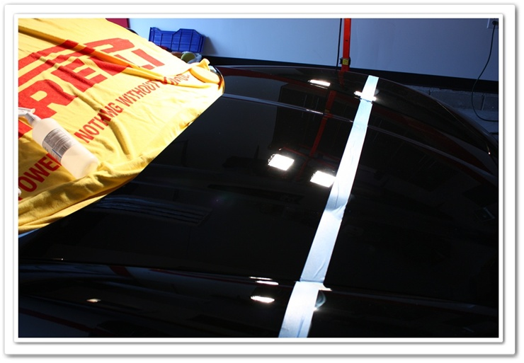 2008 black Chevy Z06 Corvette hood polished with Menzerna PO106FA Super Finish