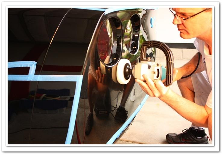 Polishing a 2008 black Chevy Corvette with a white polishing pad and Makita buffer