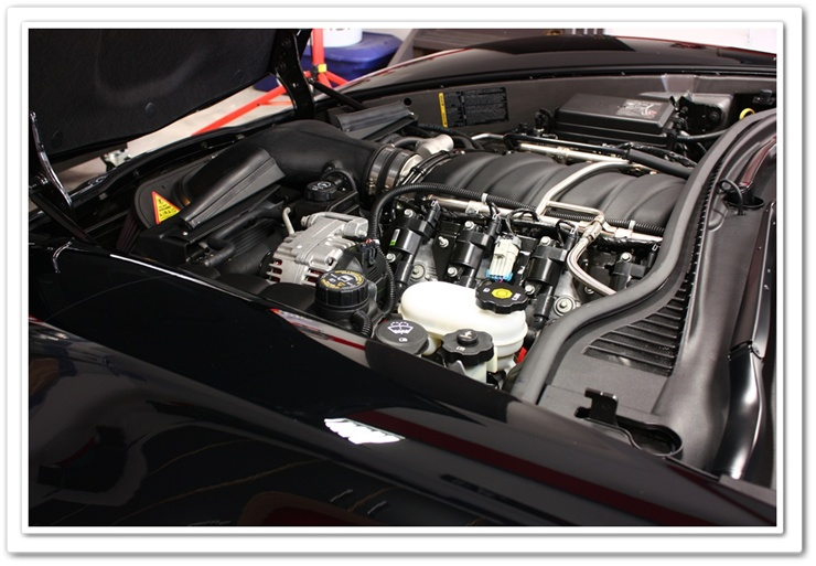 2008 black Z06 Chevy Corvette with engine cover removed