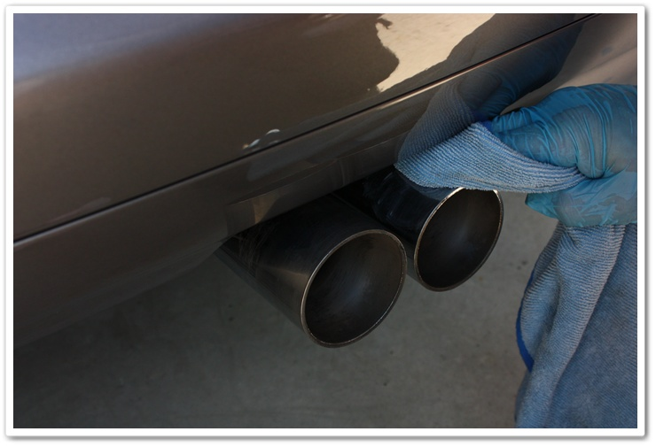 BMW M3 exhaust tips polished with Klasse All In One and a microfiber towel