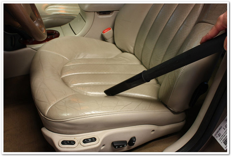 Vacuum seat to remove loose debris before Leatherique